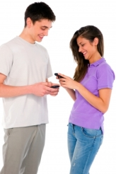 Two teens on their phones.